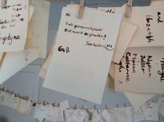 Notes written by visitors using the quill pen and ink