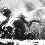 Japanese_troops_firing_a_heavy_machine_gun