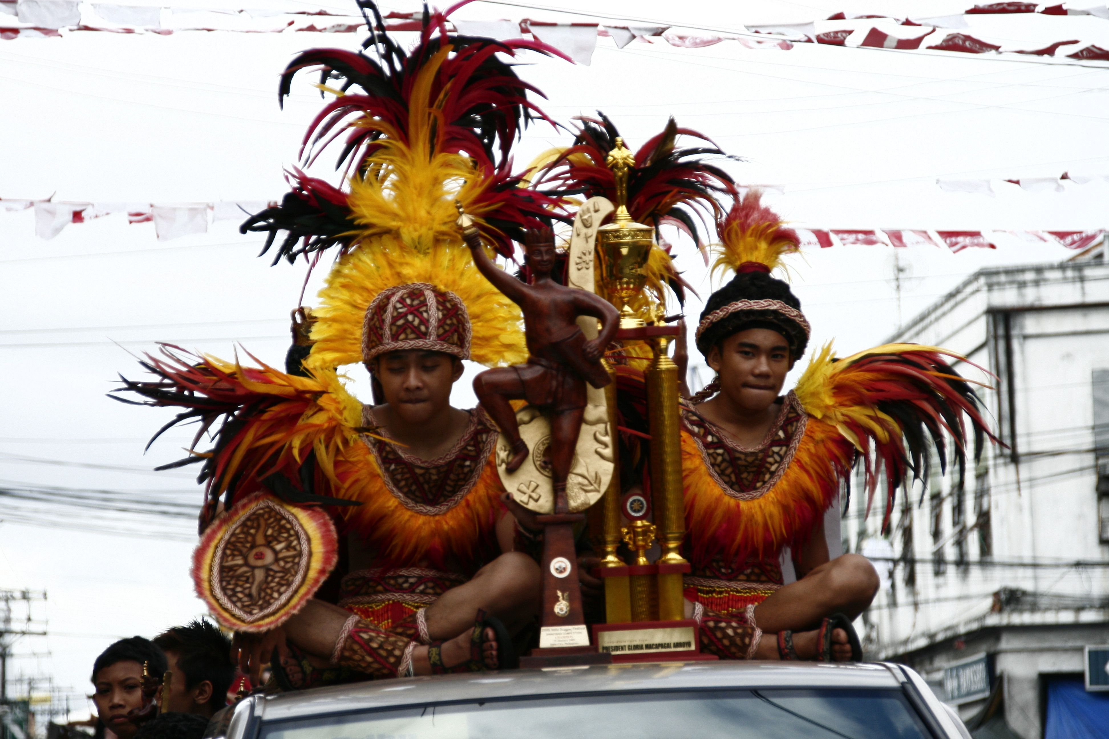 Members of Tribu Paghida-et parade their championship trophy Monday afternoon. (Photo by Tara Yap)