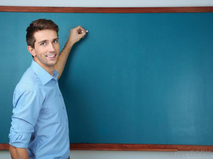 teacher at chalkboard