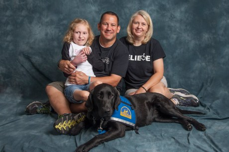 Mackenzie with parents, Lisa and Allen Dunckelman, and Canine Companions Skilled Companion Illia.