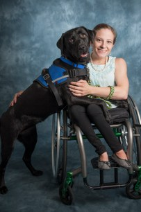 Melanie Knecht, a senior majoring in music therapy at Texas Women's University, and Canine Companions Service Dog Hillary V.
