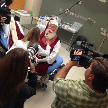 "Jane Sadler, MD, a family medicine physician on staff at Baylor Medical Center at Garland, examines ""Santa"" Chuck Lee on Friday morning."