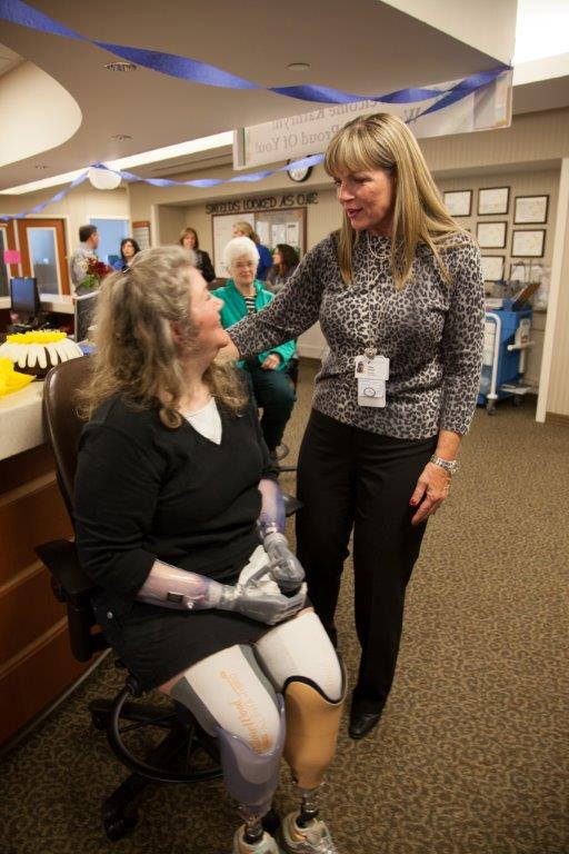 Jerri Garison, President of Baylor Regional Medical Center at Plano, greets Kuehn during her anniversary visit.