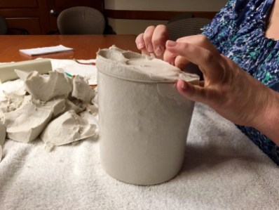 Trish removing the gel from clay molding.