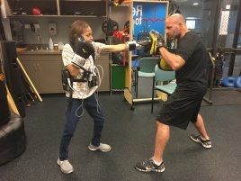Patient Tarutala Patel and boxing instructor Rey Perez