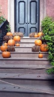 Halloween pumpkins on Greenwich Village brownstone steps.