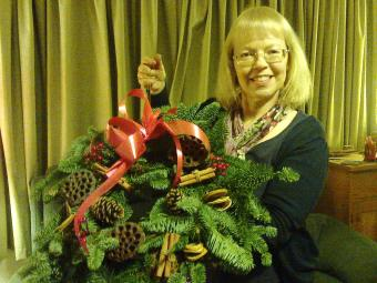 Sheila with home-made Christmas wreath