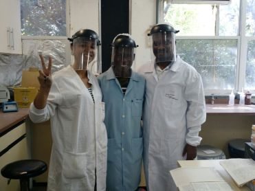 Myself (on the right), Modeste (on sky blue lab coat) and Carol (the female) in the lab from hospital (HEMOBA) after sample collection