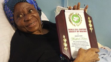 Honorary award presented to Prof. Winifred Kaine on her recovery bed