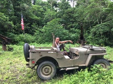 Local Munda man Alfie Rex Lai poses with his fully restored WWII jeep, a labor of love that took him almost 10 years. (Photo credit: Rebecca Strauss)