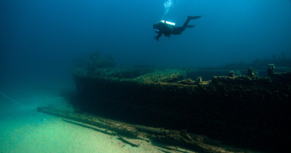 A diver swims above the wreck of D.M. Wilson. (Photo credit: David J. Ruck/NOAA)