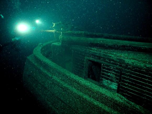 A NOAA archaeologist documents the stern of Windiate. (Photo credit: Steve Sellers/NOAA)