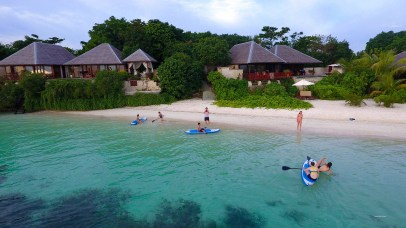 Participants in Kids Sea Camp enjoy some topside paddleboarding between dives (Photo by Margo Peyton)