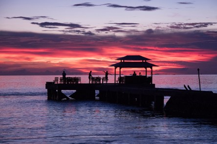 Watch the sun go down over the sea with a cocktail in hand at the Jetty Bar before dinner. Photo credit: Walt Stearns