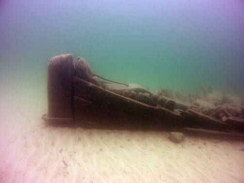 At midnight, the Big Five Dive team plunged into Lake Superior waves just off the shores of Pendills Creek National Fish Hatchery. The unknown wreck was rumored to be in the area, and was located in 2004 during a Whitefish Point Underwater Preserve aerial survey. (Photo credit: Stephanie Gandulla)
