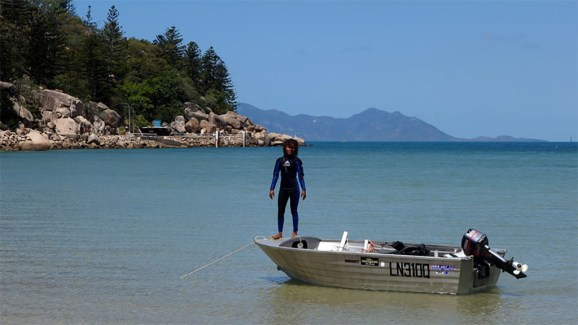 Loading dive gear on Magnetic Island, Papua New Guinea