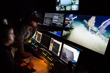 The science team in the E/V Nautilus control van monitor the dive and identify potential sampling targets. Photo: Susan Poulton/OET