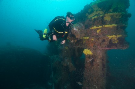 A diver inspects the Caribsea's triple expansion engine, an area of high relief. (Photo credit: NOAA)