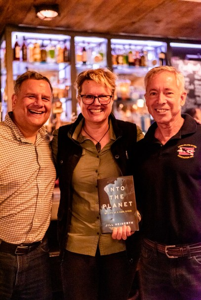 It was all smiles at the book launch after-party. Heinerth appears here alongside Joseph Sferrazza, president of the NYC Sea Gypsies (left) and Barry Lipsky, president of the Long Island Divers Association (right). (Courtesy of Suzanne Sferrazza)