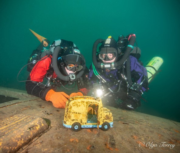 "Serious tech divers investigating a child's toy ""wreck"" makes this wonderful, silly photo more memorable than just a standard shot. Photo courtesy of Olga Torrey of Fit Image."