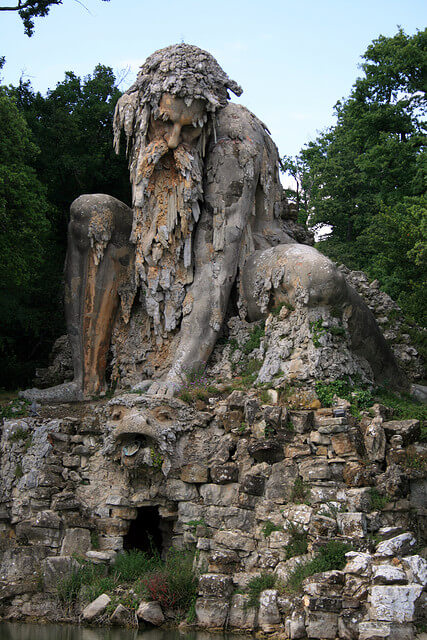 Giant man mountain sculpture photo Daniele