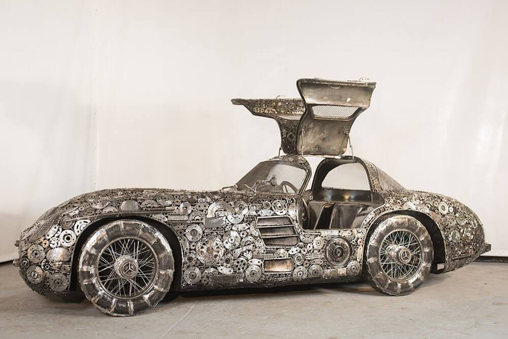 salavaged steel gull wing car sculpture