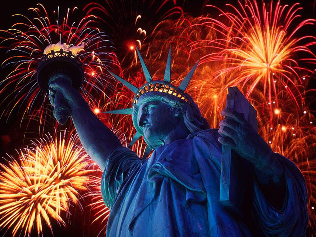 statue of liberty with fireworks