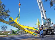Monumental sculpture Reaching for Knowledge installation