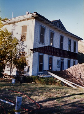 The Pico Cottage in Mentryville, where the writer lived in the 1960s, was knocked off of its foundation and its porch roof fell off in the 1994 Northridge Earthquake. Photo circa 1995 by Leon Worden.