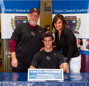 Dakota Prochnow signs with a Kansas college in April.