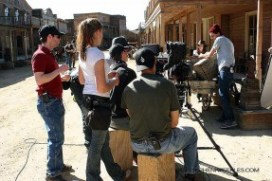 "Director-Editor Kirk Murray (red shirt) preps a scene for ""Six-Gun Savior"" on Main Street, Melody Ranch. The indie film is due out in 2014."