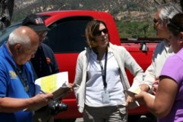 """Virgilio """"Gil"""" Macion of the U.S. Small Business Administration (far left) , Michael Hooper of the Los Angeles County Office of Emergency Management, Sonia Brown of the Cal EMA Southern Region, Francis Dominguez of the Los Angeles County Department of Public Works and Theresa Gonzales of Cal EMA discuss property impacted by the Powerhouse Fire during a joint Preliminary Damage Assessment conducted by Cal EMA and the SBA on June 17 to verify fire-related damages. CalEMA"""
