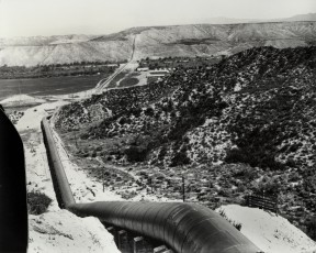 L.A. Aqueduct, shortly after it opened in 1913. Centre Pointe Business Park is in the foreground; the Greenbrier mobile homes are in the distance. In between is Soledad Canyon Road.