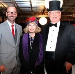 Auctioneer Mark Drilling (left) with festival founders Myrna and Gary Condie. Photo: M. Buttelman