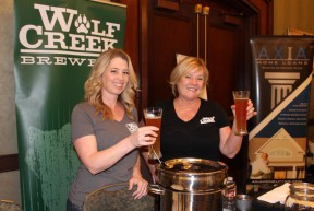Laina McFerren and Beth Wageman of Wolf Creek toast their signature chili.