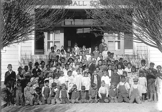 Newhall sixth graders line up for a class photo in 1919 in front of the school, which was split apart after it closed in 1928.