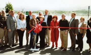 Connie Worden-Roberts (in red) at a ribbon cutting for the cross-valley connector in 2010.