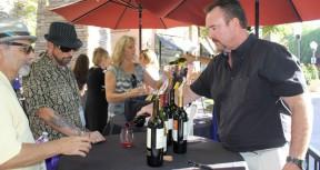 Greg Amsler, owner of Salt Creek Grille, pours a wine tasting at the Wine Affair.
