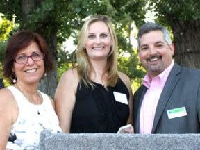 Left to right, DaAnne Smith, Lindsay Schlick and Martin Rodriguez announce the honoree and artist pairings for the 2015 Empowering HeArts fundraiser for Single Mothers Outreach. Photo by Michele E. Buttelman.