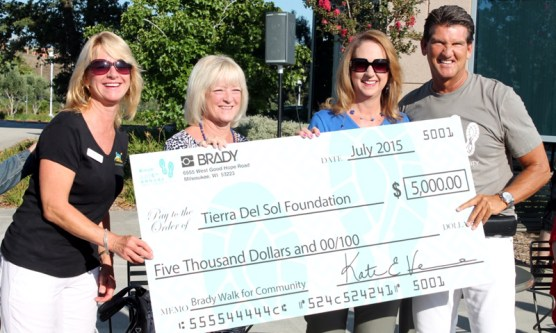Robert Case, PDC President (at right) presents a $5,000 donation to representatives of the Tierra Del Sol Foundation, (L-R) Cathy Galarneau, Jan Maseda and Rebecca Lienhard.
