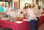 Guests were able to bid on dozens of gift baskets, art works, gift certificates and other items in the Western Silent Auction. Photo by Michele E. Buttelman.
