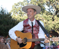 """Mild Bill of """"Mild Bill and the Mild Cats"""" walked through the crowd singing and bantering at Silents Under the Stars. Photo by Michele E. Buttelman."""
