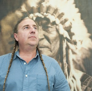 American Indian Studies director Brian Burkhart stands in his office. Photo by Luis Garcia.