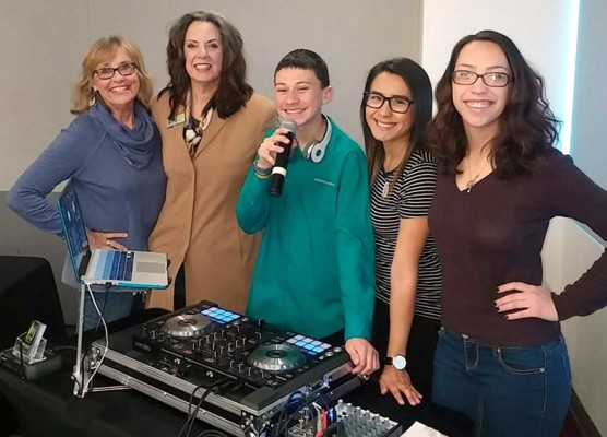:  Linda Davies of the Domestic Violence Center of SCV (and event Co-Chair) and Sue Reynolds of Hart School District led sessions, joined here by young DJ Tyler, as well asHere Brenda Yanez and Lexi Hospodar of the DVC.