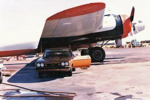 Circa 1978, the writer waxes his car in the shade under a Cal Fire B-17's wing at the Porterville air base.