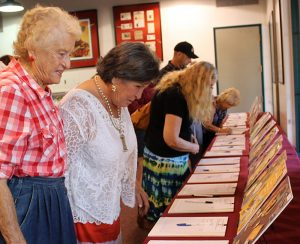 Guests view a few of the more than 90 silent auction items to benefit the Friends of Hart Park.