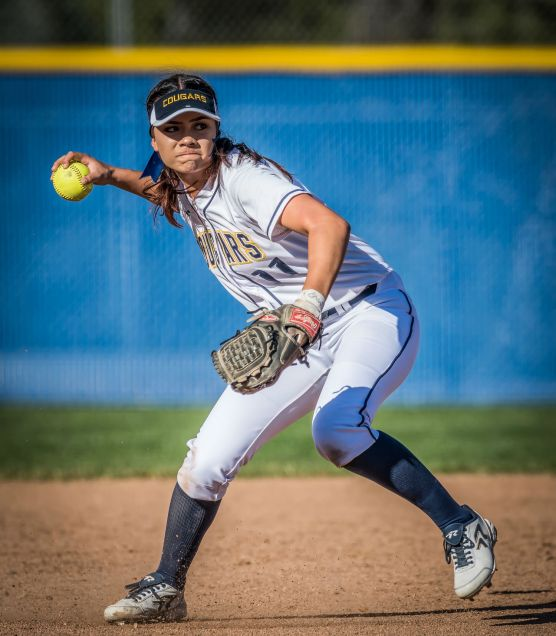 College of the Canyons shortstop Danielle Chatman fields the ball and throws late to first during the second inning Thursday, February 8, 2018 against Ventura College at Whitten Field. | Photo: Kevin Karzin