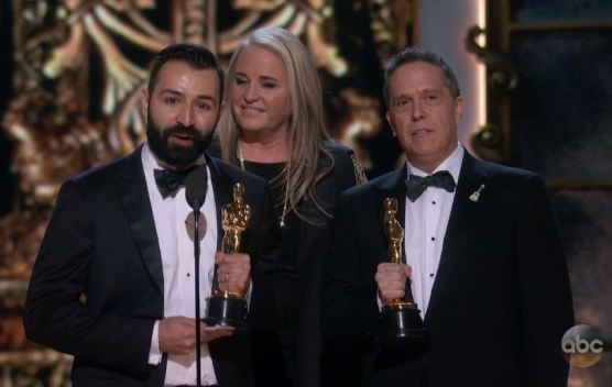 """Adrian Molina, Darla K. Anderson and Lee Unkrich accept their Oscars for """"Coco,"""" the """"Best Animated Feature"""" in the 90th Academy Awards on March 4, 2018. Photo: ABC."""