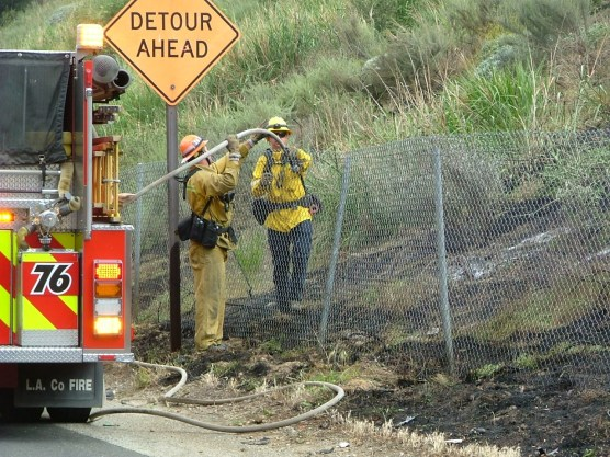 Brush fire on The Old Road, Sunday, April 219, 2018. | Photo: Kevin Gilley/two8nine media.